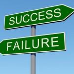 Verkeersboren met daarop 'succes' en 'falen'.